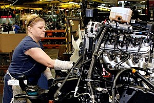 Woman Works On GM Truck Engine