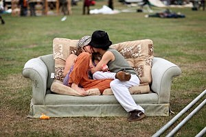 Couple Makes Out On A Couch Outdoors