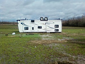 Picture of overturned travel trailer