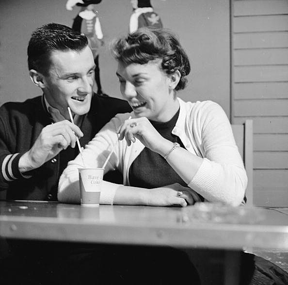 Picture of a couple sharing a shake