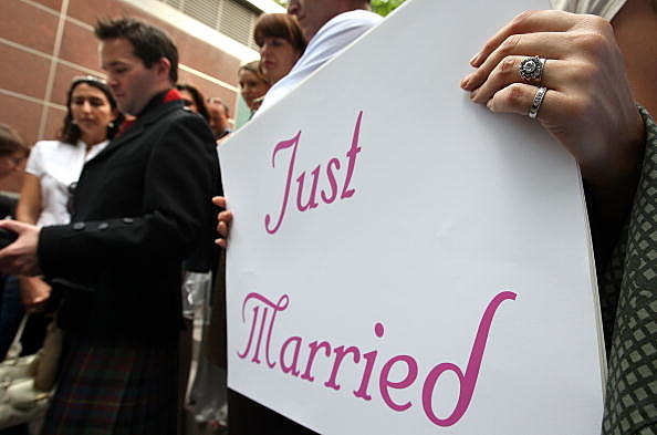 Someone Holds A 'Just Married' Sign