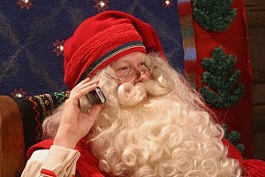 Santa Claus Takes A Call On His Mobile Phone