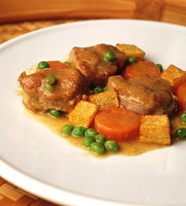Veal ragout with carrots, peas and potatos