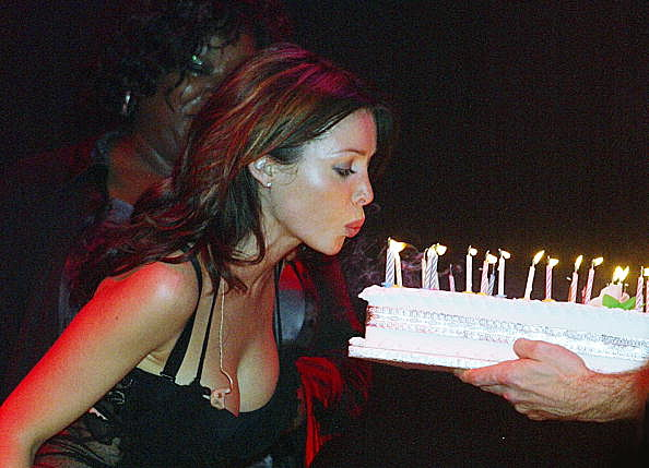 Woman Blows Out Candles