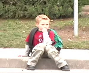 boy on curb