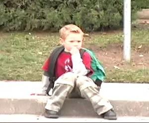 boy on curb