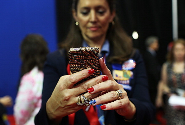 Woman Checks Her Cell Phone