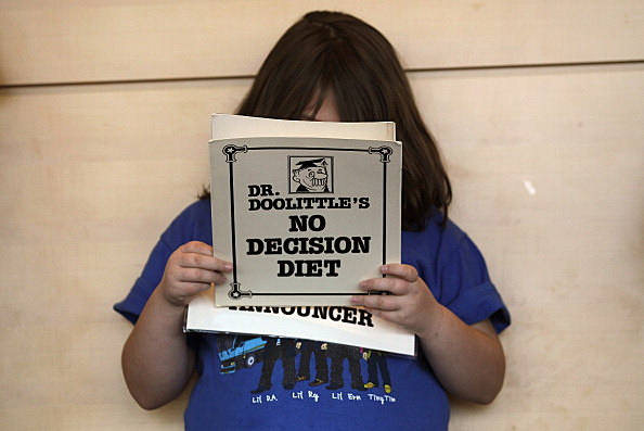Woman Reads Diet Book