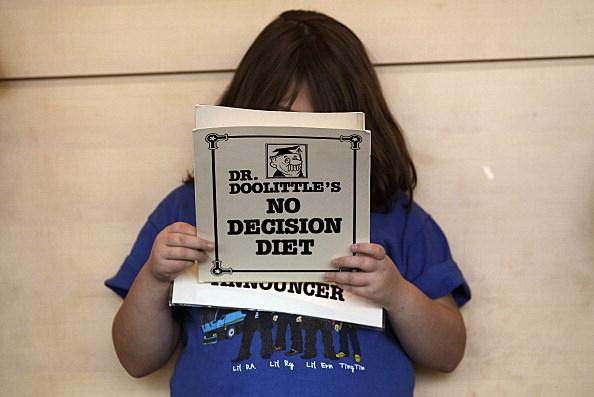 Woman Reads Diet Book
