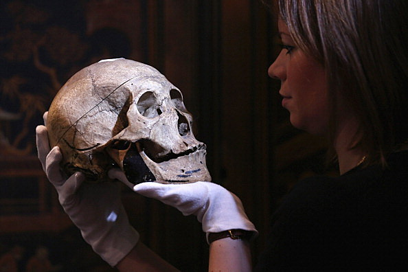 Woman Holding Skull