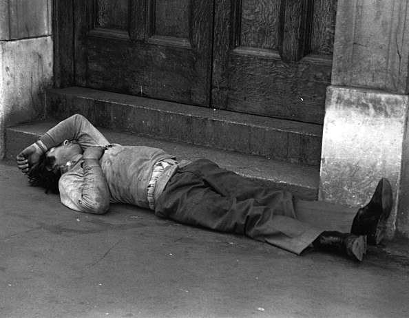 Asleep In Doorway
