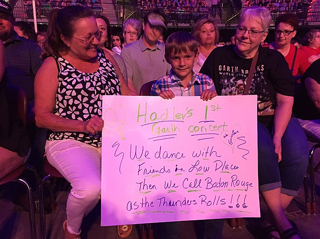 Hadley Gould Holding Sign
