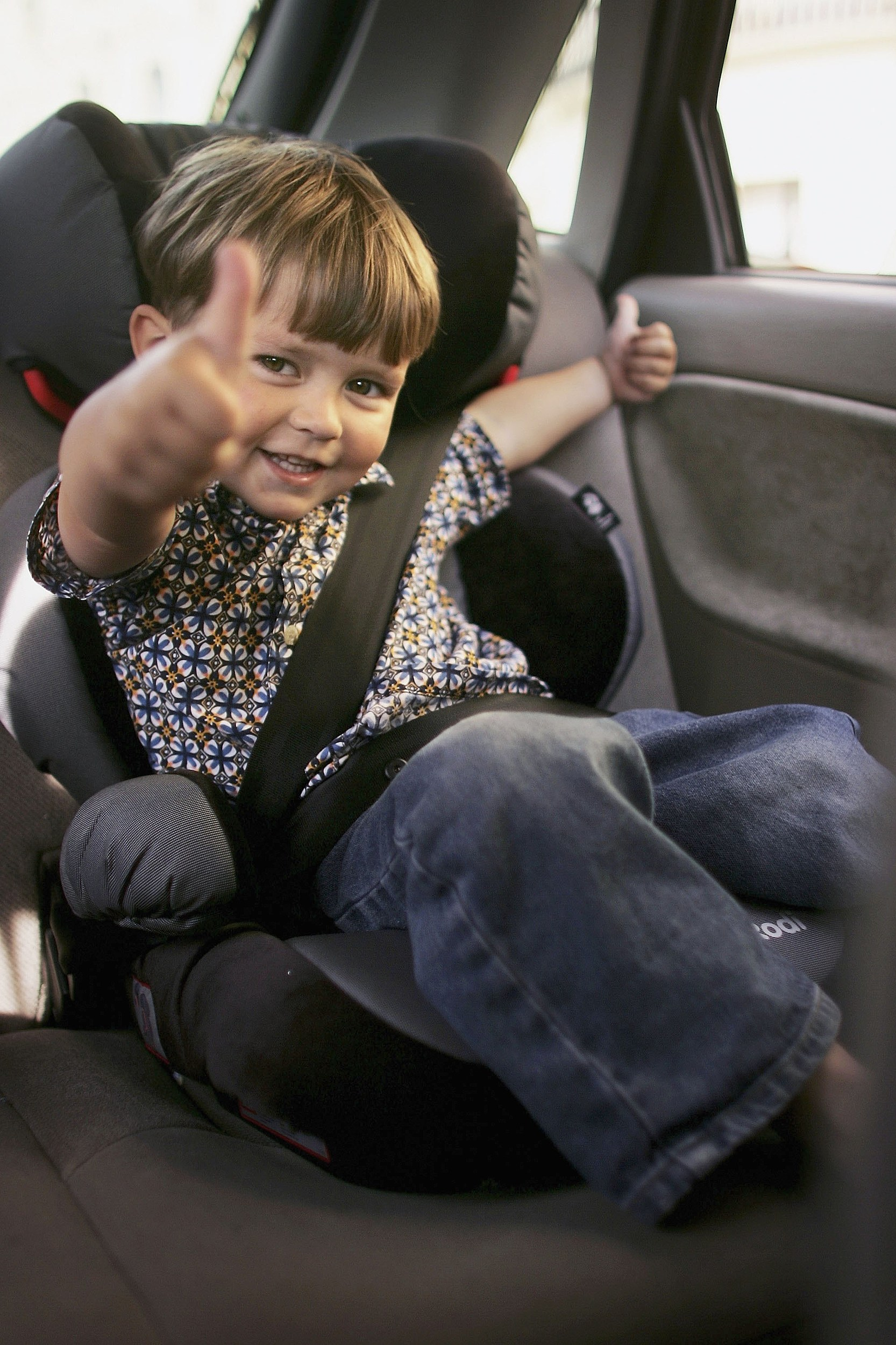 boy in car safety seat